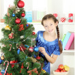 Little girl decorating christmas tree — Stok Fotoğraf #18038581