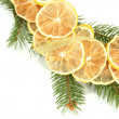 Christmas wreath of dried lemons with fir tree isolated on white — Stockfoto