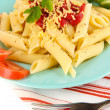 Rigatoni pasta dish with tomato sauce close up - Stockfoto
