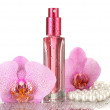 Women's perfume in beautiful bottle and orchid flowers, isolated on white — Stock Photo