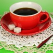 A cup of strong coffee on green background — Stock Photo