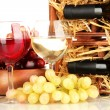 Wooden case with wine bottle, wineglasses and grape isolated on white — Stock Photo