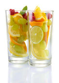 Transparent glasses with citrus fruits, isolated on white — Stock Photo