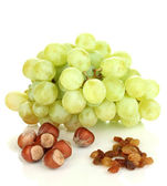 Green grape with nuts isolated on white — Stock Photo