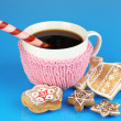 Cup of coffee with Christmas sweetness on blue background — Photo