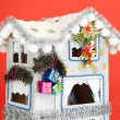 Decorated Christmas house on red background — Stok fotoğraf