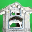 Decorated Christmas house on green background — Stock Photo