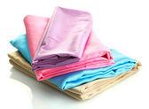 Heap of cloth fabrics isolated on white — Stock Photo
