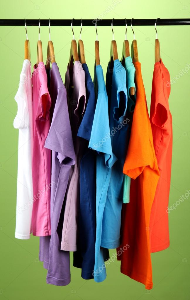 Variety of casual shirts on wooden hangers,on blue background — Stock Photo #18040269