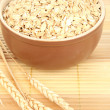 Brown bowl full of oat flakes — Stock Photo