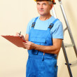 Builder enters into contract on work on wall background — Stock Photo #18051449