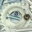 Stock Photo: Machine gear, metal cogwheels, nuts and bolts background, close-up