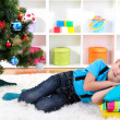 Little boy sleeping under Christmas Tree waiting for Santa Claus to come — Stock Photo #18051731