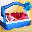 Wedding basket with rose petals - Stock Photo