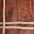 Frame composed of rope on wooden background — Stock Photo