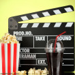 Movie clapperboard, cola and popcorn on background — Zdjęcie stockowe