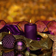 Christmas composition with candles and decorations in purple and gold colors — Stock Photo