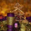 Christmas composition with candles and decorations in purple and gold colors — Stock Photo #18052047