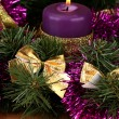 Christmas composition with candles and decorations in purple and gold colors on wooden background — Stock Photo #18052063