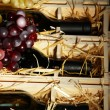 Stock Photo: Wooden case with wine bottles close up