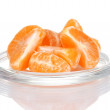 Tangerine on saucer isolated on white - Stock Photo