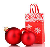 Christmas paper bag for gifts with christmas toys on grey background — Stock Photo
