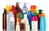 Un montón de diferentes productos cosméticos para el cuidado personal aislado en blanco — Foto de Stock