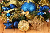 Christmas composition with candles and decorations in blue and gold colors on wooden background — Стоковое фото