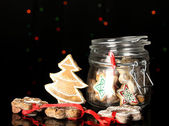 Christmas treats in bank on Christmas lights background — Stock Photo