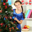 Little girl decorating christmas tree — Stok Fotoğraf #18061829