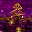 Christmas composition with candles and decorations in purple and gold colors on bright background — Stock Photo #18065265