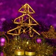 Royalty-Free Stock Photo: Christmas composition  with candles and decorations in purple and gold colors on bright background