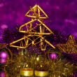 Christmas composition with candles and decorations in purple and gold colors on bright background — Stock Photo #18065267