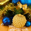Christmas composition  with candles and decorations in  blue and gold colors on wooden background — Stock Photo