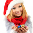 Attractive young woman holding Christmas balls isolated on white — Stock Photo