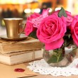 Royalty-Free Stock Photo: Beautiful pink roses in vase on wooden table on room background
