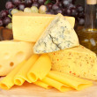 Stock Photo: Various types of cheese on wooden board