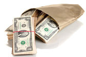 Bag with stacks of dollars isolated on white — Stock Photo