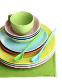 Colorful plates on napkin isolated on white — Stock Photo