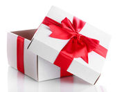 Gift box with red ribbon, isolated on white — Stock Photo