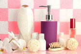 Bath accessories on shelf in bathroom on pink tile wall background — Stock Photo
