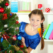 Little girl decorating christmas tree — Stockfoto #18106455