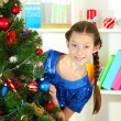 Little girl decorating christmas tree — Stock Photo #18106455