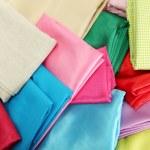 Heap of cloth fabrics, close up — Stock Photo #18107409