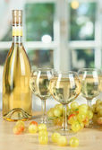 White wine in glass with bottle on window background — Stock Photo
