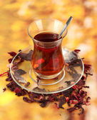 Glass of Turkish tea on color background — Stock Photo