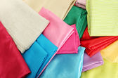 Heap of cloth fabrics, close up — Stock Photo