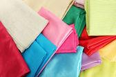 Heap of cloth fabrics, close up — Stock Photo