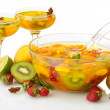 Punch in bowl and glasses with fruits, isolated on white — Stock Photo