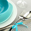 Royalty-Free Stock Photo: Blue empty plates with fork, spoon and knife on a grey tablecloth